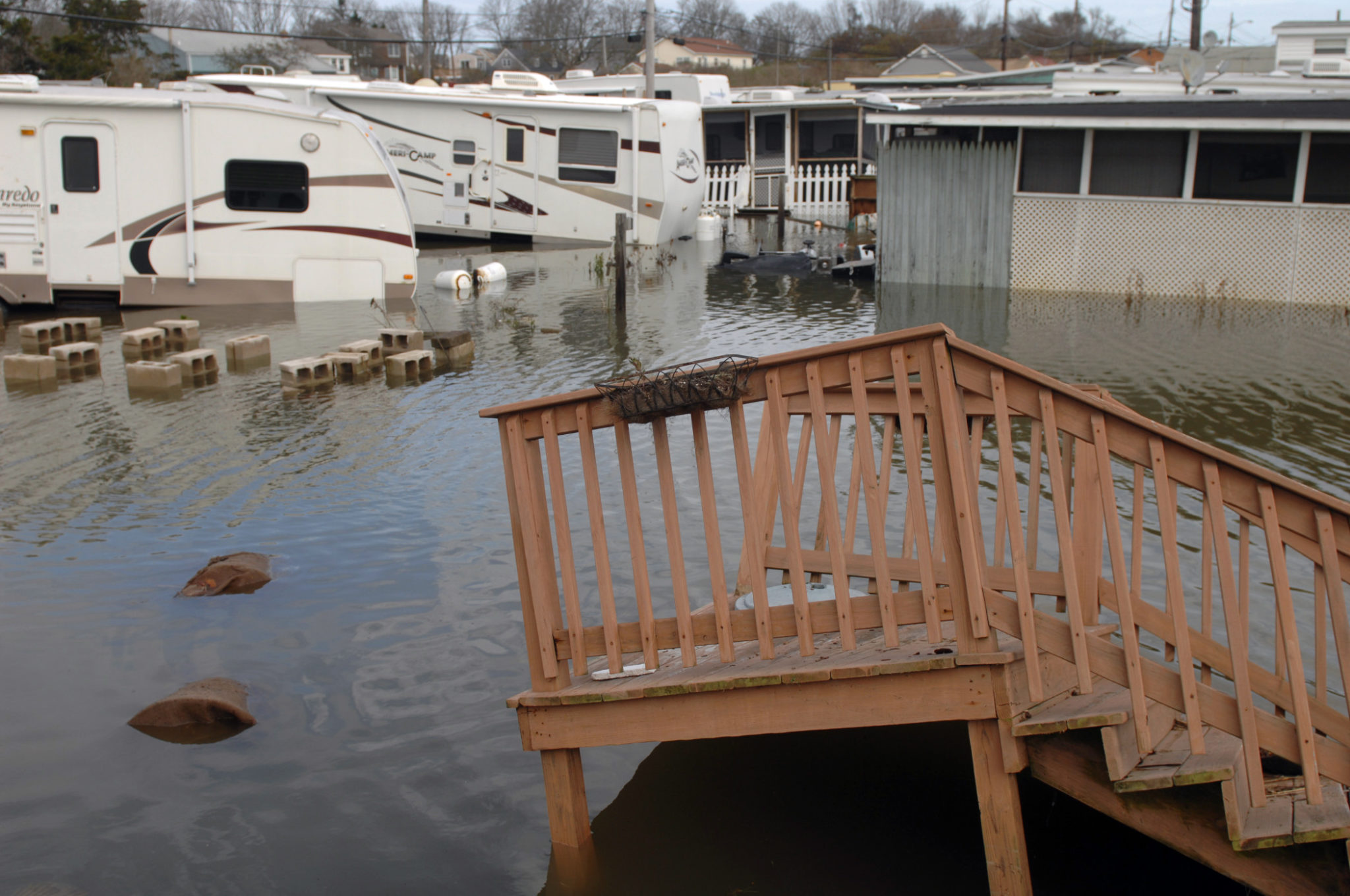 A CHANGE HAS COME: A trailer park on Matunuck Beach Road, South Kingstown, was flooded following Hurricane Sandy in 2012. Climate scientists believe that climate change is warming the planet and will result in more frequent and more powerful storms.