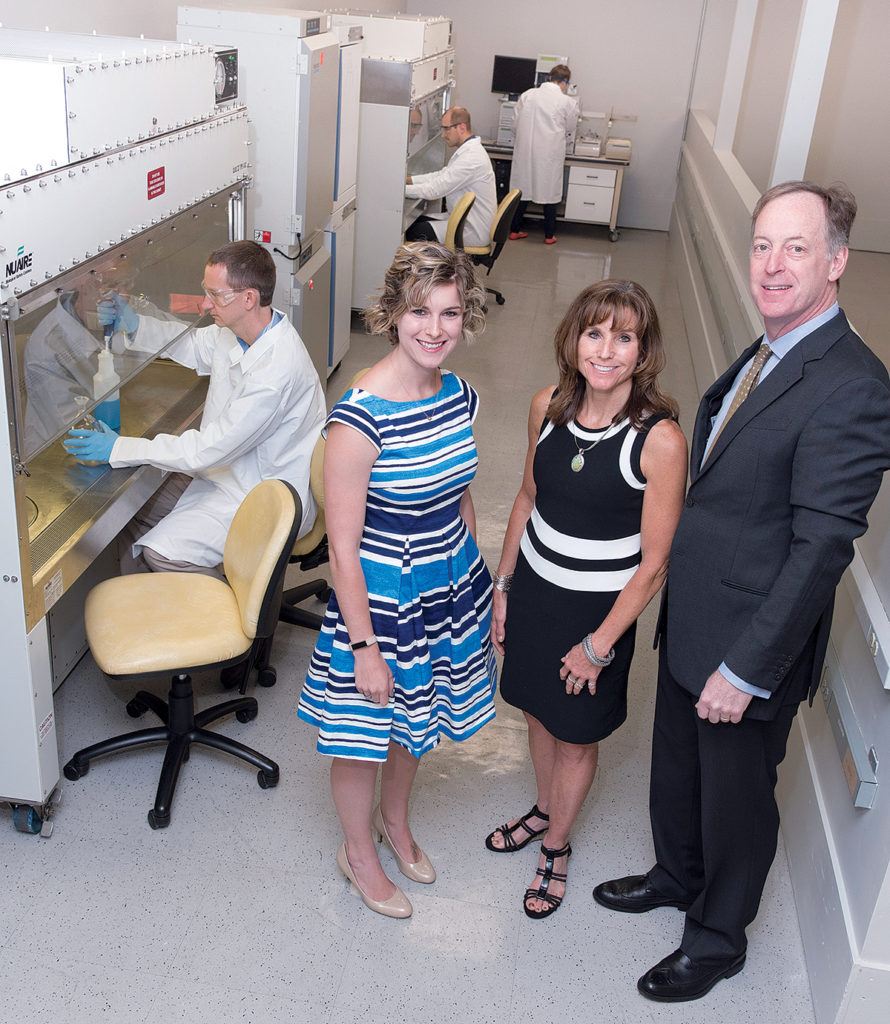 NEW INCUBATOR: BioSci Labs is a newly created, combined workspace and incubator in Coventry. From left, standing, Elizabeth A. Stone, director of BioSci Labs; Krista A. Jarrell, investor; John D. Jarrell, president of Materials Science Associates and Biointerface Inc. Seated and working, front to rear, Jay Vincelli, director of Materials Characterization and Failure Analysis Lab; Michael A. Stone, director of Marine Research; Crystal M. Vogel, research assistant from Veterans Assembled Electronics. / PBN PHOTO/MICHAEL SALERNO