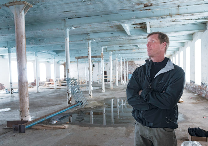 NEW VISION: The former Pontiac Mills site in Warwick will be transformed into housing and commercial space, if developer Larry Silverstein, president of Baltimore-based Union Box Co., sees his plans realized. / PBN PHOTO/MICHAEL SALERNO