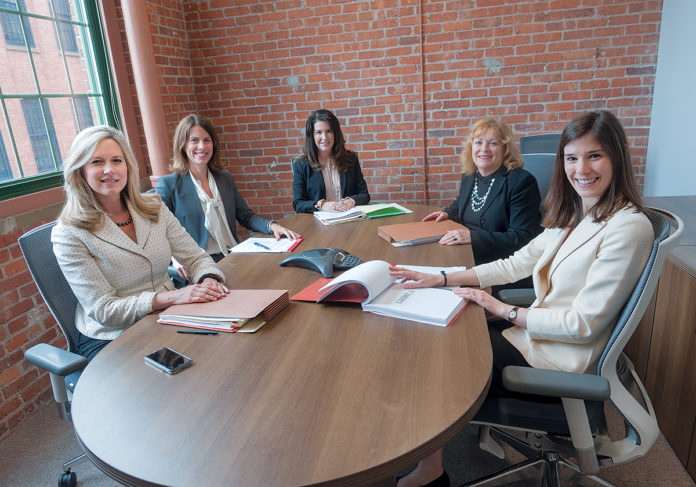 TEAM ­PLAYERS: Cervenka Green Ducharme Antonelli LLC offers flat fees for services because many clients prefer it. From left, partners Jennifer Cervenka, Rachelle Green, Diana Ducharme and Patricia Antonelli, with associate ­Emily ­Migliaccio. / PBN PHOTO/­MICHAEL SALERNO
