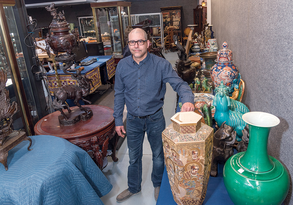 ECLECTIC COLLECTION: Kevin Bruneau, owner of Bruneau & Co. Auctioneers, which specializes in appraisals and auctions of fine art, antiques and collectibles, with a collection of pieces referred to him by a Barrington Realtor.  / PBN PHOTO/MICHAEL SALERNO