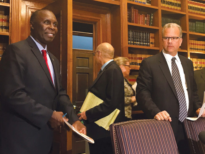 A RETURN TO OLD-STYLE POLITICS? House Finance Committee Chairman Marvin L. Abney, left, with House Speaker Nicholas A. Mattiello, right, have devised a $9.2 billion spending plan for fiscal 2018 that moves money around in odd ways to come into balance.  / PBN FILE PHOTO/ELI SHERMAN