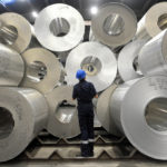 A WORKER COUNTS stocks of sheet aluminum rolls. /BLOOMBERG FILE PHOTO/OLIVER BUNIC