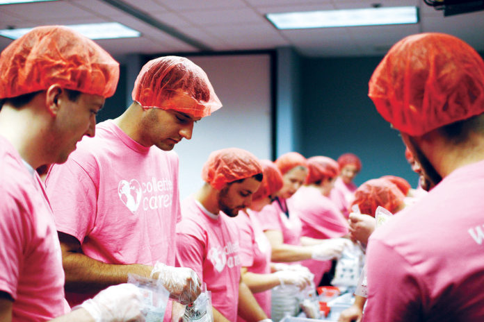 COMMUNITY CONNECTION: Collette staff packaged more than 30,000 meals during a meal packaging event in conjunction with Rise Against Hunger. / COURTESY COLLETTE