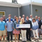 TEAM BUILDING: Compass IT Compliance makes sure that its staff, often out of town for work, gets the opportunities at the home office to connect and build the team. / COURTESY COMPASS IT COMPLIANCE