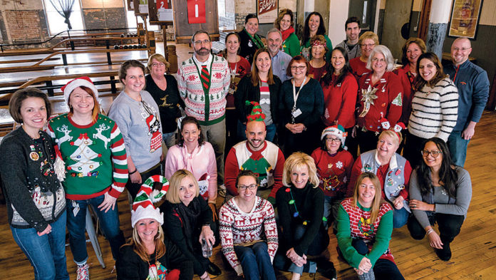 POSITIVELY RESPONSIVE: Healthcentrc Advisors staff demonstrate their flexibility, whether adapting to rapidly changing professional demands or celebrating a holiday party. / COURTESY HEALTHCENTRIC ADVISORS