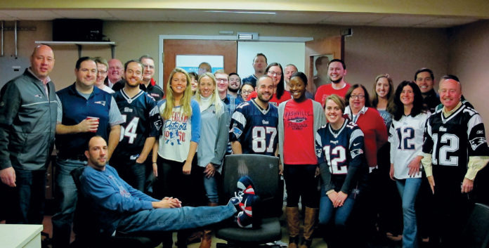 A SPIRITED WORKPLACE: Prior to the New England Patriots Super Bowl victory in February, KLR staff showed their true colors in the office. / COURTESY KAHN, LITWIN, RENZA & CO.