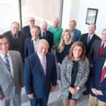 CLEAR PROGRESS: The board of the Narragansett Bay Commission takes a moment in 2016 to celebrate the opening of the new Water Quality Science Building. / COURTESY NARRAGANSETT BAY COMMISSION