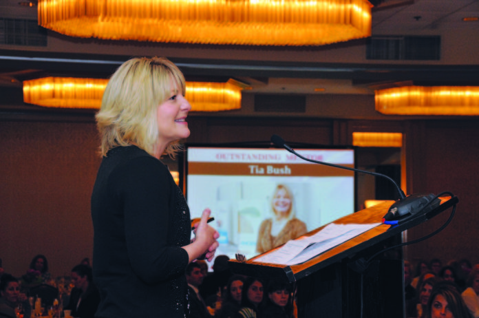 AMGEN RHODE ISLAND VICE PRESIDENT FOR SITE OPERATIONS Tia Bush addresses the audience at the 2017 PBN Business Women Awards program luncheon upon receiving her award. / PBN FILE PHOTO/MIKE SKORSKI