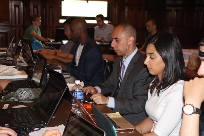 PROVIDENCE MAYOR JORGE O. ELORZA, middle, first partnered with IntraCity Geeks in 2015 to start the nonprofit's free Code Night web development events. COURTESY INTRACITY GEEKS