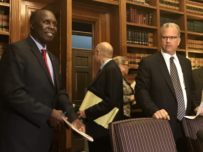 R.I. HOUSE FINANCE Chairman Marvin L. Abney, left, with House Speaker Nicholas A. Mattiello, right, on June 15 unveiled the Democrat's $9.2 billion spending plan for fiscal 2018. / PBN FILE PHOTO/ELI SHERMAN