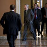 SENATE MAJORITY LEADER MITCH McConnell, a Republican from Kentucky, center, walks to a private GOP meeting at the U.S. Capitol. /BLOOMBERG FILE PHOTO/ANDREW HARRER