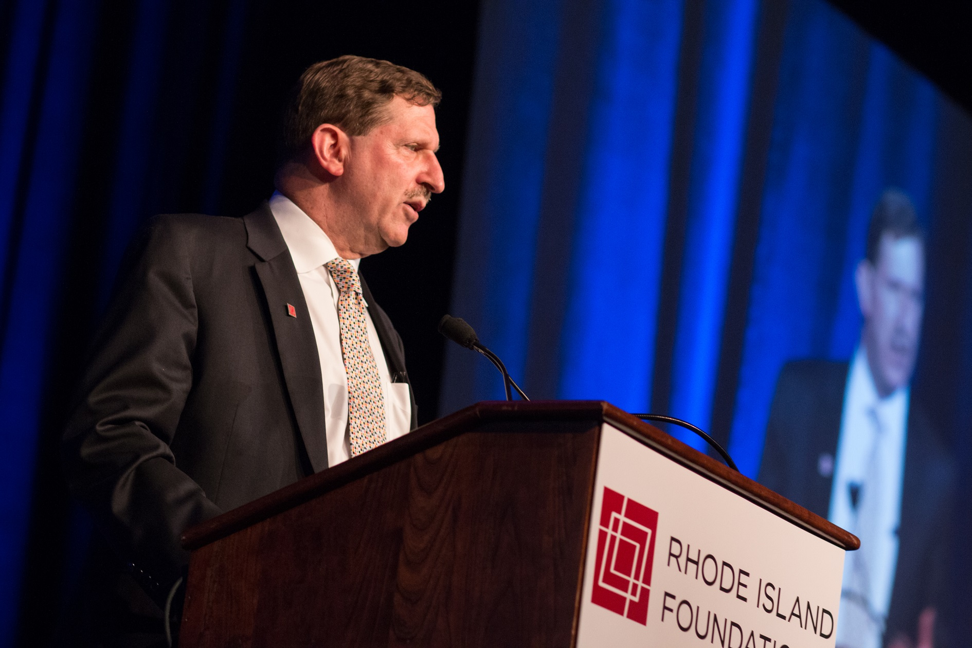 NEIL D. STEINBERG speaks at the Rhode Island Foundation's annual meeting in 2015./ COURTESY OF RHODE ISLAND FOUNDATION.