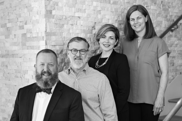 THE TAYLOR & ASSOCIATES TEAM, from left, Robert Rutley, Nelson Taylor, Rachael Dotson and Robin Lake, has affiliated with Mott & Chace Sotheby's International Realty. /COURTESY MOTT & CHACE SOTHEBY'S INTERNATIONAL REALTY