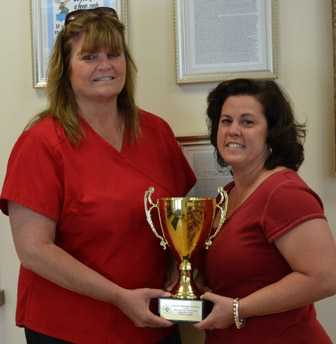 WELLONE'S PROGRAM coordinators, Lisa Schiffman, left, nurse care manager, and Nicole Masse, accept an award at a June 2 WISEWOMAN meeting. /COURTESY WELLONE