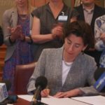 GOV. GINA M. RAIMONDO SIGNS an executive order to reaffirm Rhode Island's commitment to the principles of the Paris Climate Accord on Monday. / COURTESY THE OFFICE OF THE GOVERNOR OF RHODE ISLAND