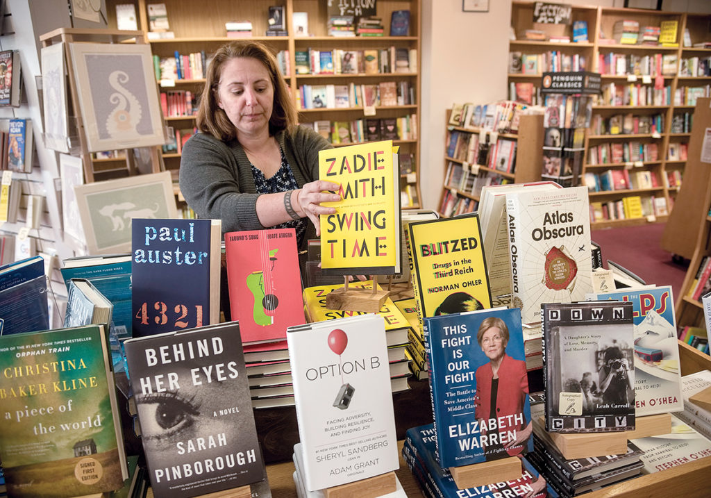 SURVIVOR: Store manager Jennifer Kandarian has worked at independent Books on the Square in Providence for the past 12 years, including surviving the store falling into receivership in 2007 and recovery under new owners. / PBN PHOTO/MICHAEL SALERNO
