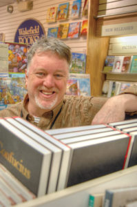 "UNIQUE ANIMAL: Bob Ryan, owner of South Kingstown-based Wakefield Books, says he prioritizes in-store experiences and attracting repeat customers over online sales, which he doesn't participate in. To accomplish this, he hires passionate readers who can ""put the right book"" in customers' hands. / PBN PHOTO/BRIAN MCDONALD"