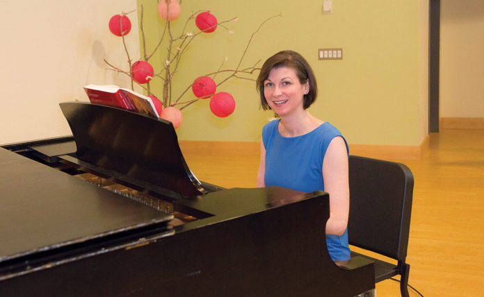 """RECONNECTING: Christine Noel co-founded the Rhode Island Children's Chorus because she missed the """"opportunity to connect with young people"""" while working abroad at the University of Florence in Italy, where she lived for nearly two years. / PBN PHOTO/TRACY JENKINS"""