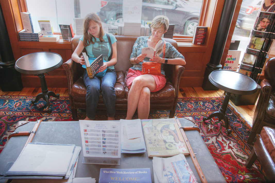 COMFORTABLE SURROUNDINGS: Customers take advantage of the café interior while checking out what's available for purchase at the Savoy Bookshop & Café in Westerly.  / PBN PHOTO/BRIAN MCDONALD
