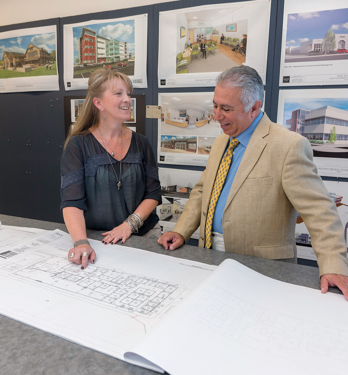 SEEKING WORK PRODUCT RESPECT: Jennifer Space, an associate at n|e|m|d architects inc., and president of the Rhode Island branch of the ­American Institute of Architects, looks over some plans with n|e|m|d architects President Mehdi Khosrovani. Space believes local firms are bypassed too often for high-profile work. / PBN PHOTO/MICHAEL SALERNO