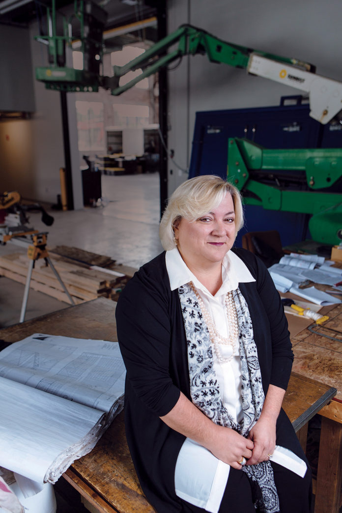 Jeanne Cola looks at ways to build vibrant communities through improvements in housing, safety, health, livability and child care facilities, something Local Initiatives Support Corporation has been doing in Rhode Island for 26 years.   / PBN PHOTO/RUPERT WHITELEY