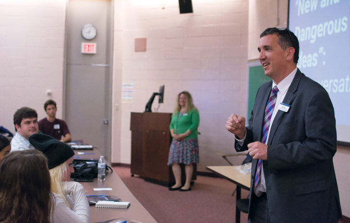 LOCAL HISTORY: Robert Shea, right, associate provost for the advancement of teaching and learning at Roger Williams University, speaks to students during Roger Seminar, which introduces first-year students to Roger Williams as a historical figure by studying texts by ­Williams and those analyzing his role in local history. / COURTESY ROGER WILLIAMS UNIVERSITY