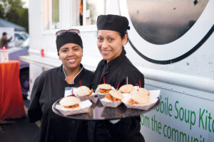 STREET EATS: Food-truck vendors serve up sandwiches during the Truck Stop: A Festival of Street Eats, an annual event sponsored by Stop & Shop and held in April in the Rhode Island Community Food Bank parking lot. / COURTESY RHODE ISLAND COMMUNITY FOOD BANK