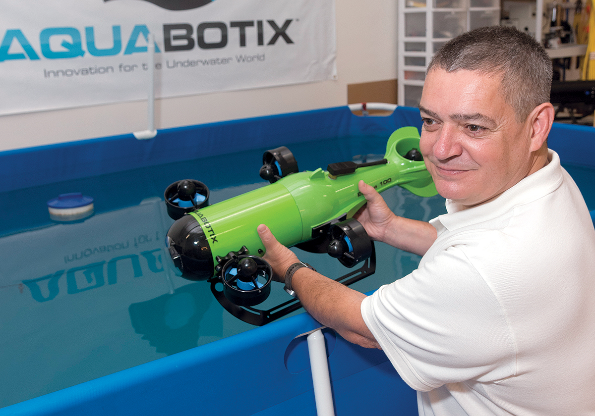 AQUABOTIX TECHNOLOGY CORP. FOUNDER DURVAL TAVARES holds one of the company's underwater drones at its Fall River offices. In a recent management shake-up, he has left the company. / PBN FILE PHOTO/MICHAEL SALERNO