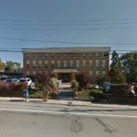 This three-story, professional offices building at 1150 New London Ave. in Cranston sold on June 29 for $2.03 million./Courtesy Sweeney Real Estate & Appraisal.