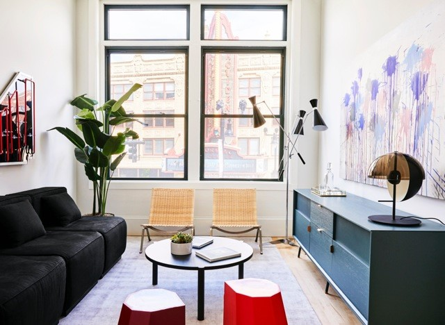 THE CONVERSION OF a pair of former office buildings to luxury residential apartments is now completed at 225 Weybosset St. Above, a living room view in one of the apartments, which are now being leased. /COURTESY ASH NYC