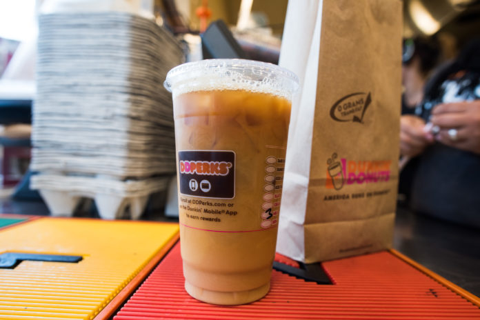 Purveyors like Dunkin' Donuts are testing the next level of speciality for cold brew, including cups infused with nitrogen, driving up global demand for coffee beans. / BLOOMBERG FILE PHOTO /RON ANTONELLI