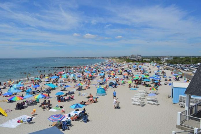 BEACHGOERS ARE SEEN at Roger Wheeler State Beach in Narragansett. / COURTESY OFFICE OF GOV. GINA M. RAIMONDO