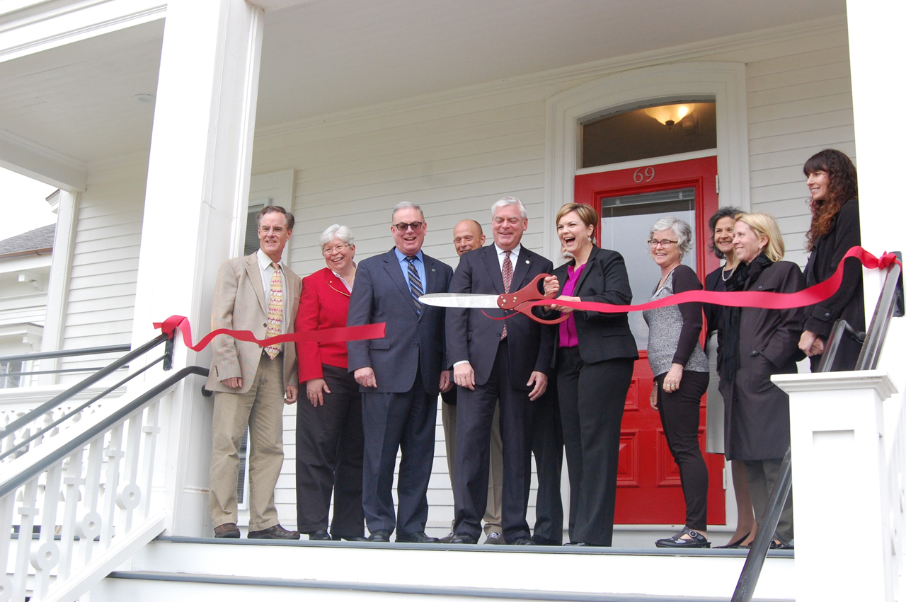 CELEBRATING A SYMBOLIC RIBBON-CUTTING on May 22 at the Pawtuxet Village Fair House, which will serve as affordable housing for the homeless and disabled, are, from left: Richard Corley, Warwick City Council member, Ward 1; Deborah Imondi, president, House of Hope; Rep. Joseph M. McNamara, D-Warwick; Mike Chapman, Fair House tenant; Warwick Mayor Scott Avedisian; Laura Jaworski, House of Hope executive director; Alice Pace, chairperson, Pawtuxet Village Association; Maria Nichols, vice president, Federal Home Loan Bank of Boston; Carol Ventura, deputy director, R.I. Housing; and Karen Flora, of the R.I. Department of Behavioral Healthcare, Developmental Disabilities and Hospitals. /COURTESY HOUSE OF HOPE COMMUNITY DEVELOPMENT CORP.