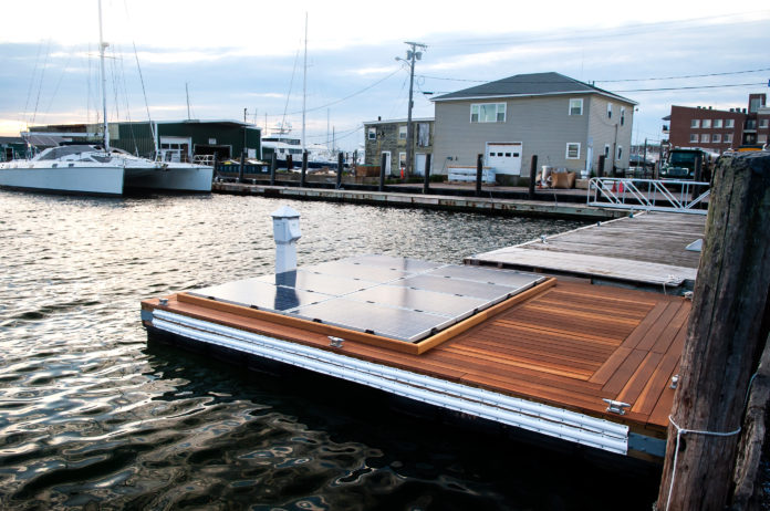 THE BLUE ISLES floating solar-panel platform, pictured above, was developed by PowerDocks LLC and launched in Newport Harbor last month. / COURTESY POWERDOCKS LLC