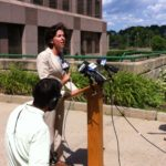 GOV. GINA M. RAIMONDO speaks to reporters Wednesday about the state budget impasse./PBN PHOTO/ MARY MACDONALD