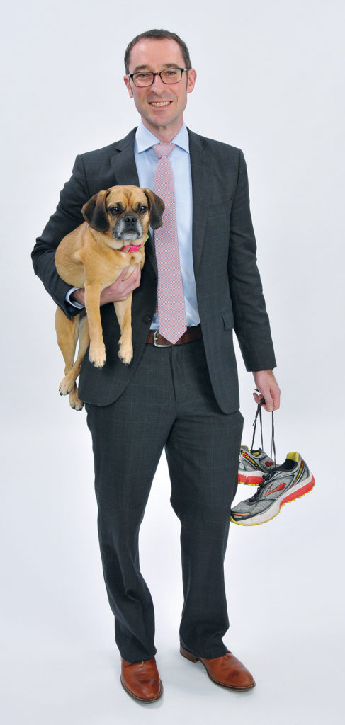 """THE PROP: Michael Baer """"lives"""" for his morning runs on Providence's East Side, although it is unclear if his puggle, Percy, accompanies him."""