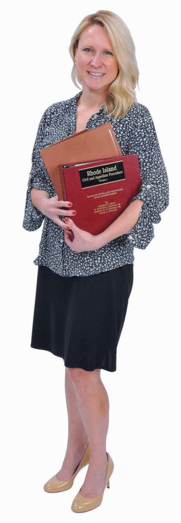 THE PROP: Sally P. McDonald seems to have a placid personality, but the law, represented by the state civil and appellate procedure manual in her hands, can bring out another side.