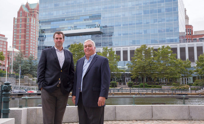 READY TO LEASE: Hayes & Sherry broker Matt Fair, left, and firm partner Peter Hayes are marketing about 3,500 square feet of available space at Providence's IGT Center. / PBN PHOTO/TRACY JENKINS