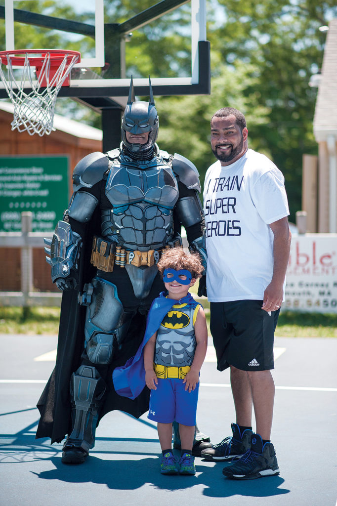 PEER HEROES: Manny DeBrito, right, formed A's be4 to train mentors to work with local youth. He's pictured with Raymond Ramos (Batman) and his 4-year-old son Theo DeBrito. / COURTESY JACKIE YOUNG/JACQUELYN CAROL CO.