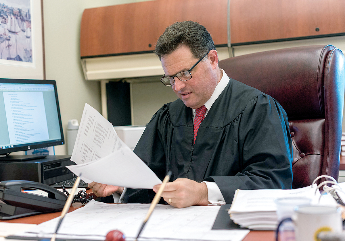 BEYOND BUSINESS: Associate Justice Brian P. Stern worked in the public sector before being appointed to the bench. Although he was named in 2011 to oversee the business calendar for Kent, Newport and Washington counties, he still presides over some criminal matters, including murders, outside of the business calendar. / PBN PHOTO/MICHAEL SALERNO