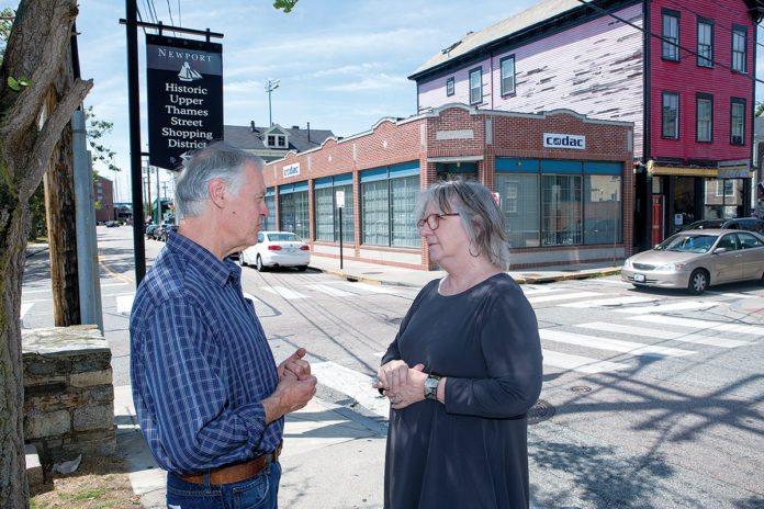 VALUABLE RESOURCE: CODAC Behavioral Healthcare Inc., headquartered in Cranston, operates six centers in Rhode Island that offer addiction-treatment services. Above, CODAC CEO and President Linda Hurley talks with Robert Babat, program administrator for Newport CODAC. / PBN PHOTO/KATE WHITNEY LUCEY