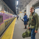 A passenger waits to board an MBTA commuter train in Providence. / PBN FILE PHOTO/­MICHAEL SALERNO / PBN FILE PHOTO/­MICHAEL SALERNO