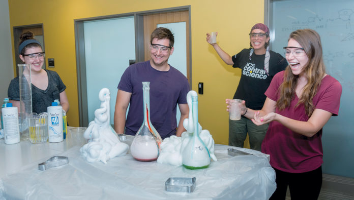 GENERATING INTEREST: University of Rhode Island graduate student Ben Cromwell demonstrates Party Elements programming. URI professor Mindy Levine started the business to get more people interested in science. / COURTESY UNIVERSITY OF RHODE ­ISLAND/MICHAEL SALERNO
