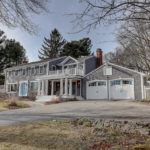 THIS SPACIOUS COLONIAL overlooking Smith's Pond at 14 Quincy Adams Road in Barrington sold in August for $1.1 million. /COURTESY RESIDENTIAL PROPERTIES LTD.