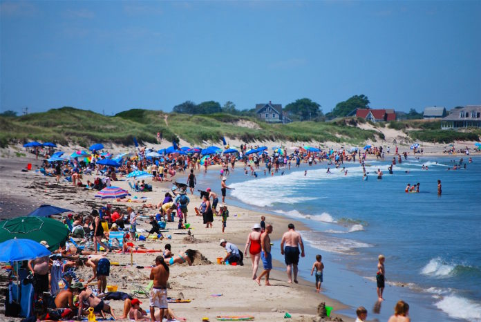 BEACH TIME! Summer and Rhode Islanders head to the beach. In this case, it's Block Island, but there are many opportunities to take in sun and surf in the Ocean State. / PBN PHOTO/K. CURTIS