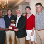 LAWRENCE A. AUBIN SR., center, co-chair of the Hasbro Children's Hospital Invitational and chairman of the Lifespan board of directors, presents the Hasbro Cup. From left, Dr. G. Dean Roye; Dr. William Cioffi; Aubin; Dr. David Harrington; and Dr. Stephen Migliori. /COURTESY AL WEEMS PHOTOGRAPHY