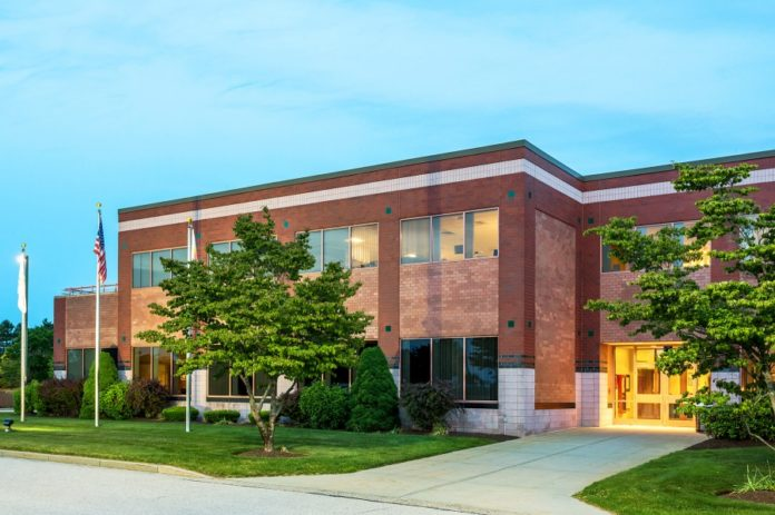 TWO SIGNIFICANT COMMERCIAL properties in the West Greenwich Business Park are scheduled to be sold via online auction in September, including this Class A office building leased by International Game Technology PLC. /COURTESY TEN-X COMMERCIAL REAL ESTATE