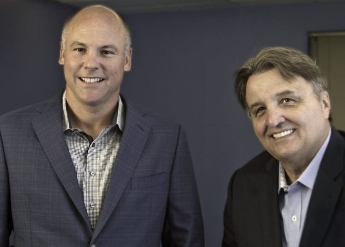 GREG BERARD, left, has been promoted to president of Lighthouse Computer Services Inc. from his former role as general manager. Founder and CEO Tom Mrva, right, said the move would free him up to focus full-time on client outreach. / COURTESY LIGHTHOUSE COMPUTER SERVICES INC.