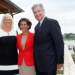 R.I. DEPARTMENT OF Environmental Management Director Janet Coit, left,,Gov. Gina M. Raimondo and Sen. Sheldon Whitehouse gather on the front deck of the new Sail Newport center after official ribbon cutting Wednesday. / COURTESY SAIL NEWPORT /ANDES VISUAL